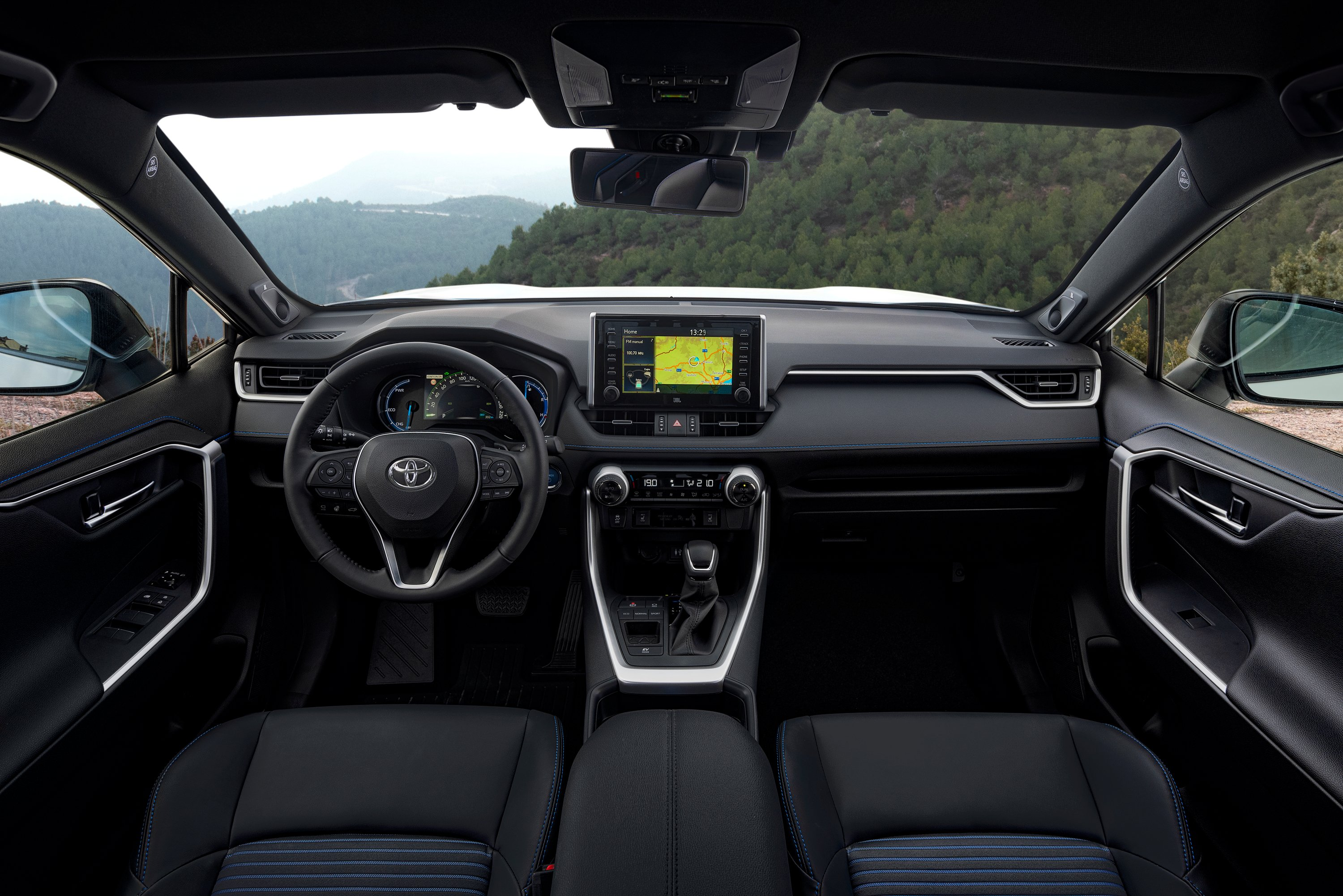The Interior Of The New Toyota Rav4 Hybrid Changing Lanes