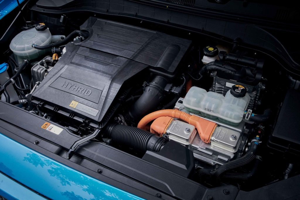 Hybrids combine a combustion engine with an electric motor and battery to reduce emissions and fuel consumption