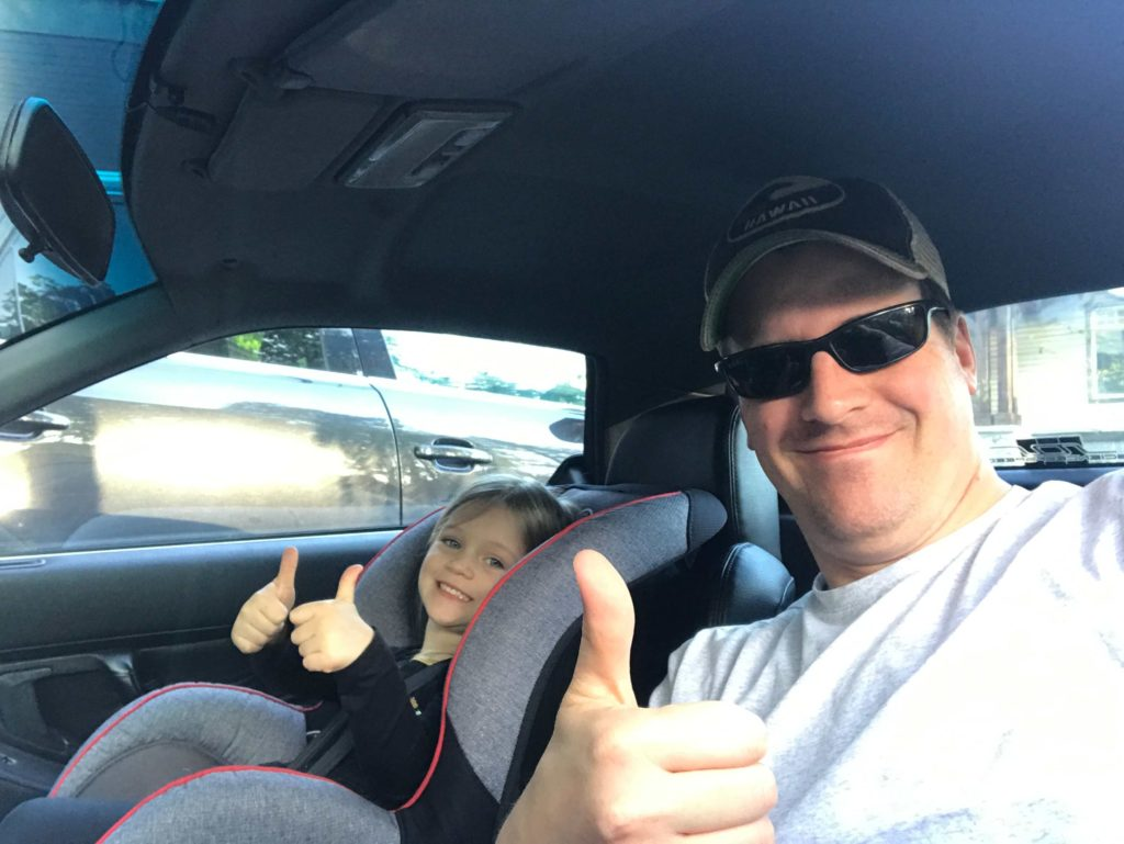 Mark and his daughter Audrey testing cabin comfort in the Honda NSX