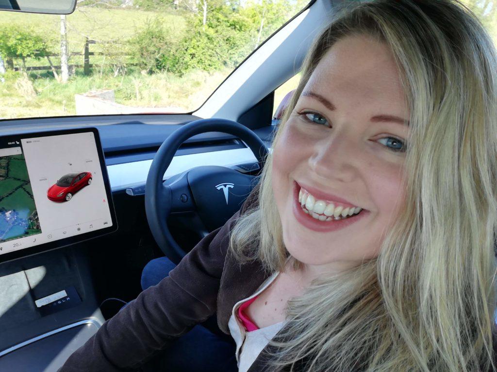 Caroline behind the wheel of the 2021 Tesla Model 3!